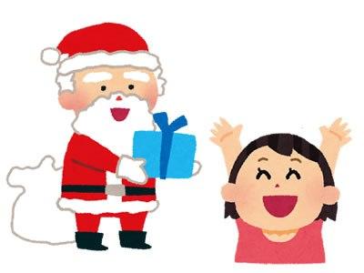 サンタさんが女の子にプレゼントを渡す画像